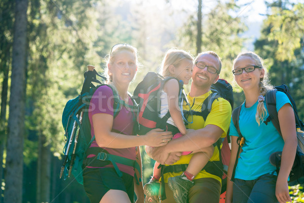 Family with two daughters on hike in the woods Stock photo © Kzenon