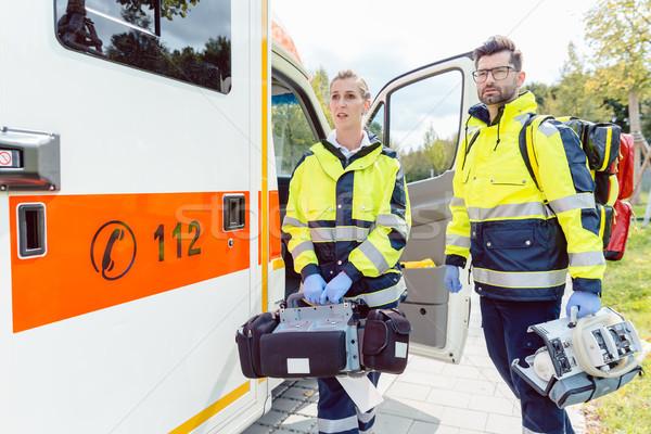 Paramedic nurse and emergency doctor at ambulance Stock photo © Kzenon