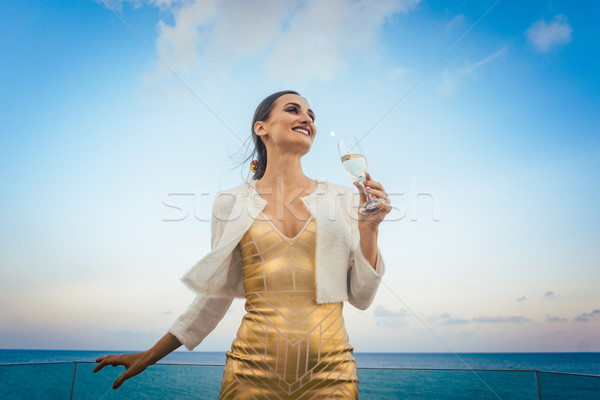 Woman sitting by the sea at a party on beach Stock photo © Kzenon