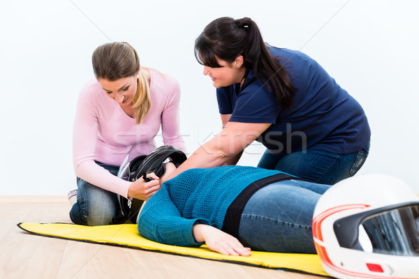 First aiders practicing to remove the helmet of injured biker Stock photo © Kzenon