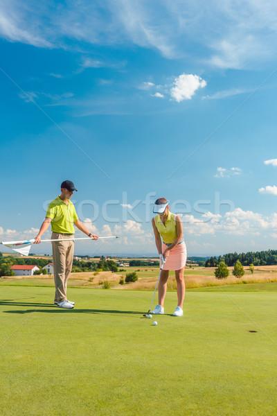 Vrouw spelen professionele golf mannelijke Stockfoto © Kzenon