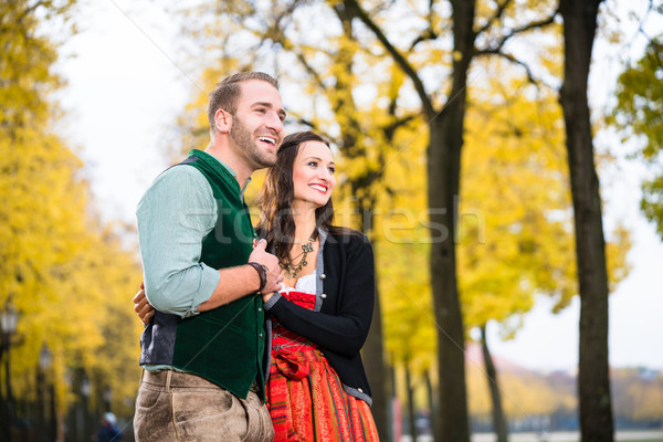 Happy Couple with Tracht in Bavaria Stock photo © Kzenon