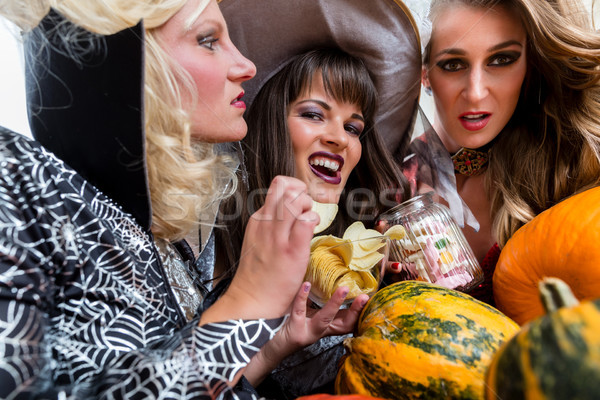 Four beautiful women having fun while celebrating Halloween together Stock photo © Kzenon