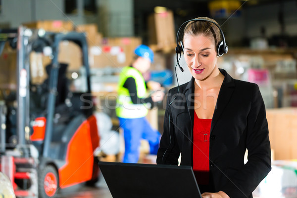 dispatcher using headset at warehouse of forwarding Stock photo © Kzenon