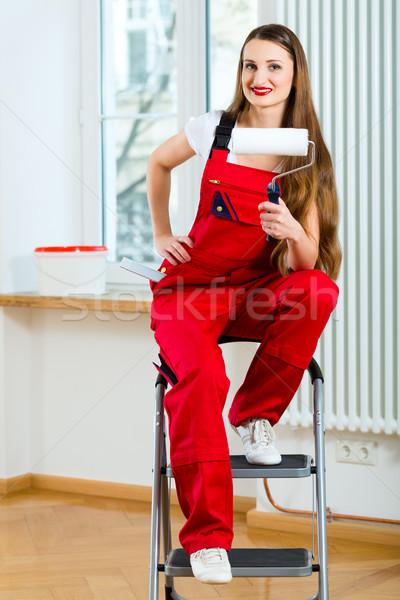 Woman renovating her apartment Stock photo © Kzenon
