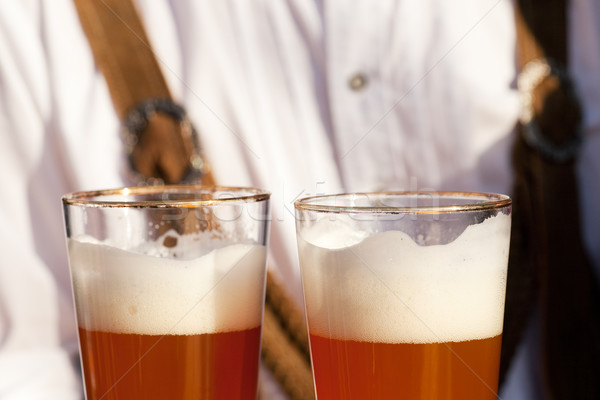 Couple in Bavarian Tracht clinking glasses  Stock photo © Kzenon