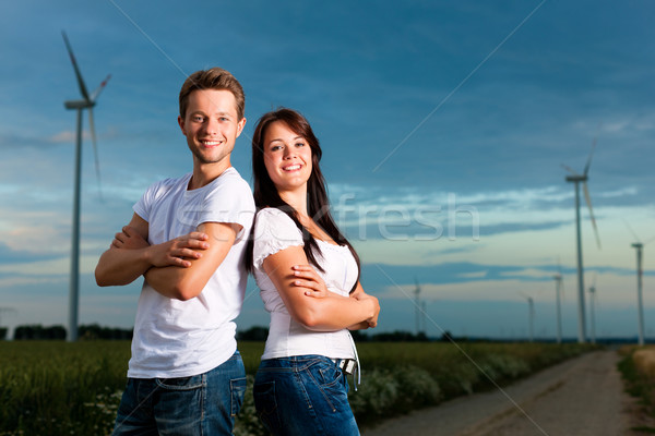 Powerful couple in front of windmill  Stock photo © Kzenon