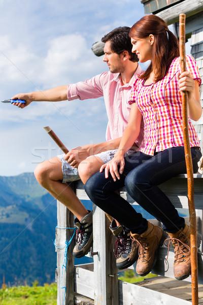 Alps - Man and woman sitting at cabin in tirol Stock photo © Kzenon