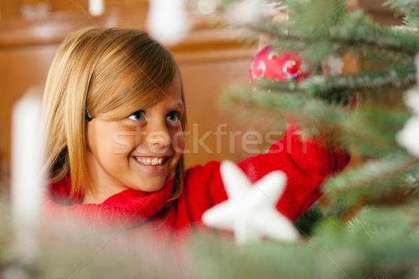 Child decorating Christmas tree Stock photo © Kzenon