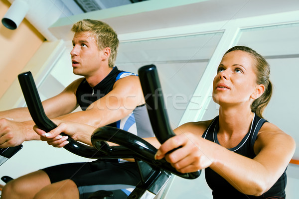 Spinning in the gym 2 Stock photo © Kzenon