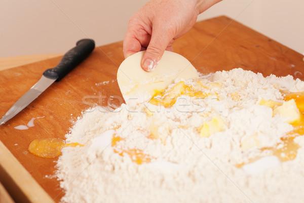 Печенье женщину масло мучной стороны Сток-фото © Kzenon