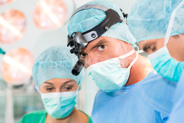 Surgeons in operating room in emergency Stock photo © Kzenon