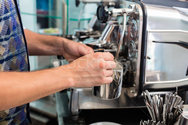 Barista in cafe or coffee bar preparing cappuccino Stock photo © Kzenon
