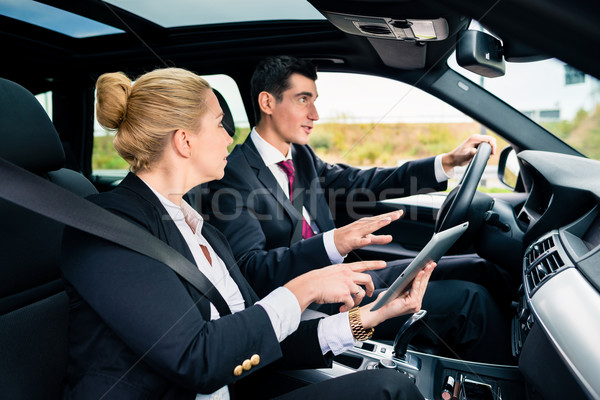 Couple in car being lost navigating with map Stock photo © Kzenon