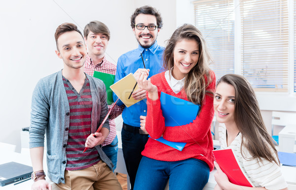 Students in College or university learning together Stock photo © Kzenon