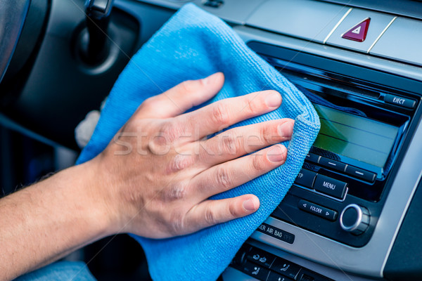 Man wiping the display glass in his car Stock photo © Kzenon