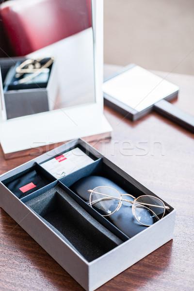Yeni gözlük sunmak kutu gözlükçü depolamak Stok fotoğraf © Kzenon