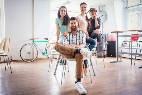 four co-workers wearing casual clothes during work in a modern h Stock photo © Kzenon