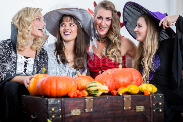 Three beautiful women acting as witches joining their malicious  Stock photo © Kzenon