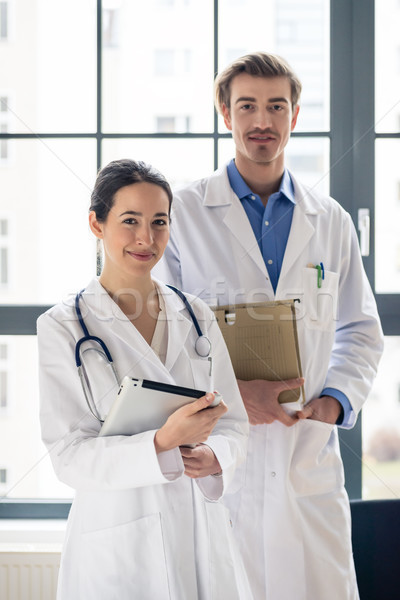 Portrait of two determined physicians looking at camera in a mod Stock photo © Kzenon