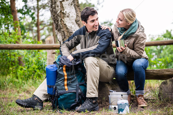 Man and woman take break from hiking and cook  Stock photo © Kzenon