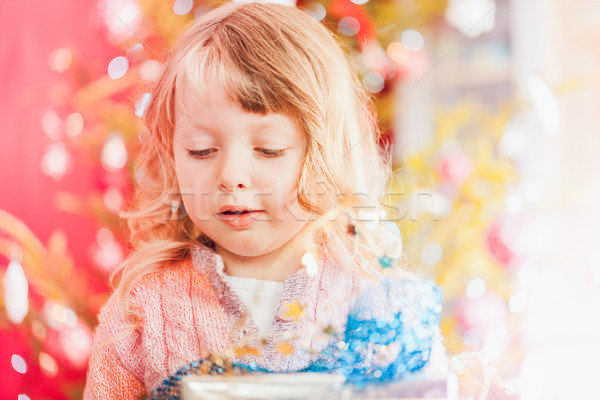 Christmas, happy little girl with Xmas present on Christmas Eve Stock photo © Kzenon