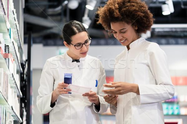 Reliable pharmacists analyzing a prescription Stock photo © Kzenon