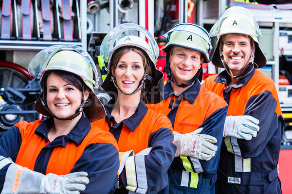 Four fire fighters doing thumbs up Stock photo © Kzenon