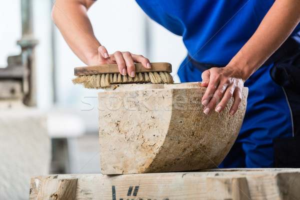 Stonemason brushing stone dust off workpiece Stock photo © Kzenon