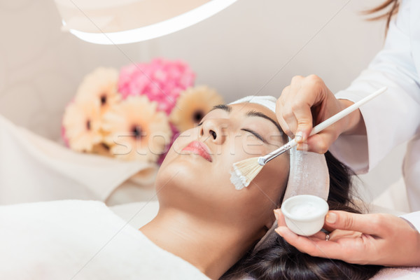 Close-up of the face of a beautiful woman relaxing during rejuvenating massage Stock photo © Kzenon