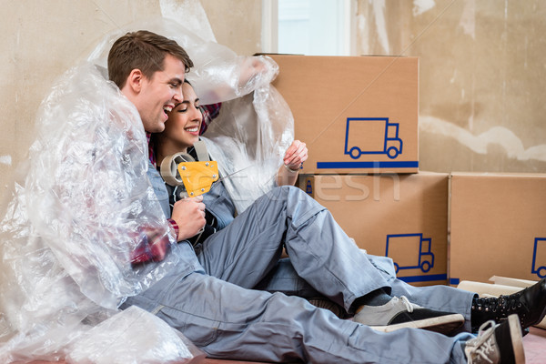 Young couple day dreaming about their future after moving in together Stock photo © Kzenon