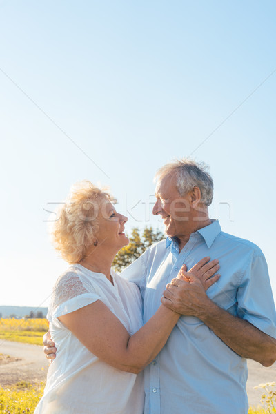 Stock photo: Romantic elderly couple enjoying health and nature in a sunny day