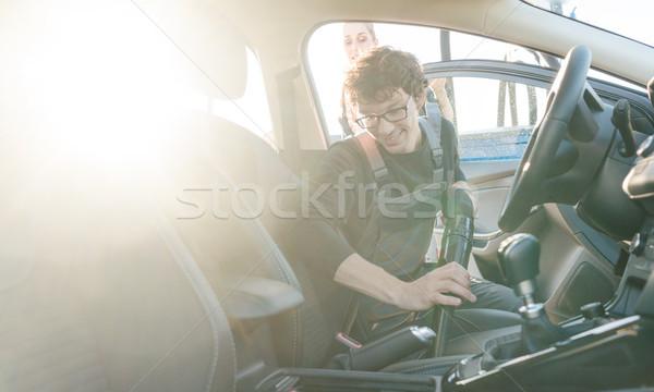 Man cleaning inside of car Stock photo © Kzenon