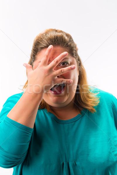 страшно женщину пальцы лице изолированный белый Сток-фото © Kzenon