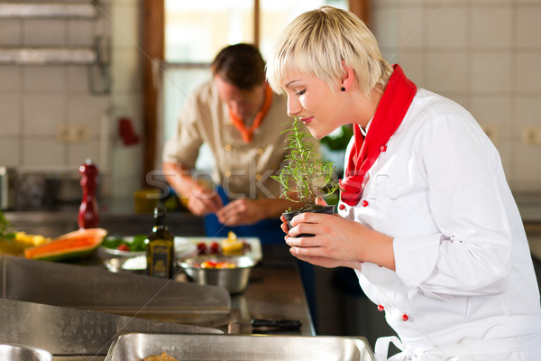 Chefs in a restaurant or hotel kitchen cooking Stock photo © Kzenon