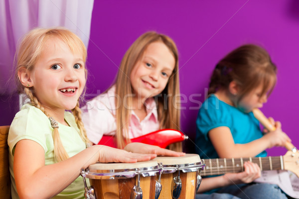 Stock photo: Children making music with instruments at home