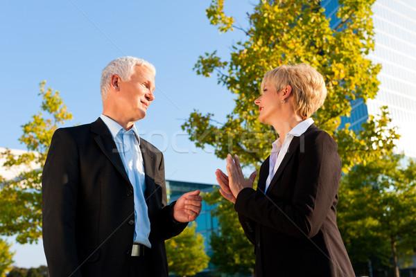 деловые люди говорить улице зрелый старший Постоянный Сток-фото © Kzenon