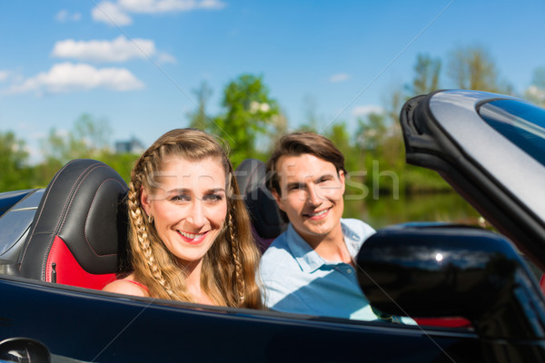 Young couple with cabriolet in summer on day trip Stock photo © Kzenon