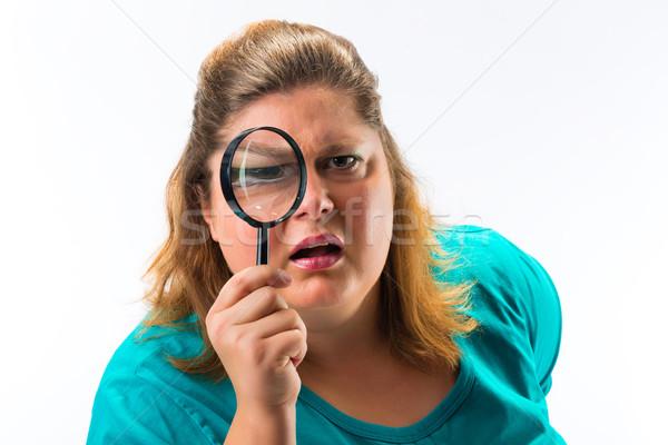 Woman looking through magnifying glass or loupe Stock photo © Kzenon