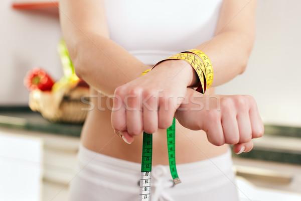 Diétázás vad nő megbilincselve mérőszalag szimbólum Stock fotó © Kzenon