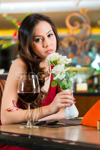 Chinese woman waiting in restaurant for date  Stock photo © Kzenon