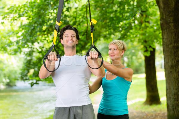 People doing suspension or sling trainer fitness Stock photo © Kzenon