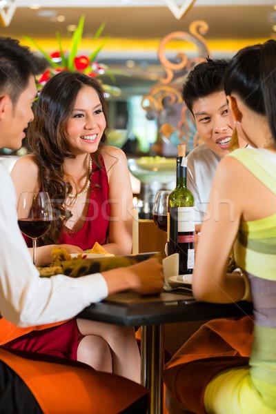 Chinese business people dining in elegant restaurant Stock photo © Kzenon