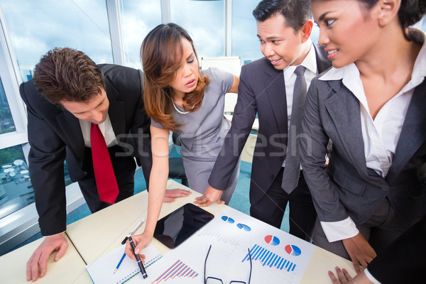 Mixed business team discussing earnings Stock photo © Kzenon