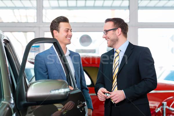 Client buying new car in dealership  Stock photo © Kzenon