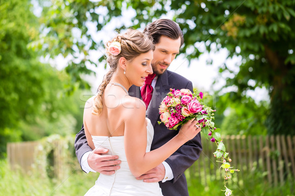 Wedding bride and groom with bridal bouquet Stock photo © Kzenon