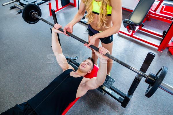 Kadın personal trainer bank basın spor salonu egzersiz Stok fotoğraf © Kzenon
