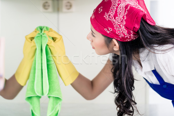 Asian homemaker cleaning the home with cloth Stock photo © Kzenon