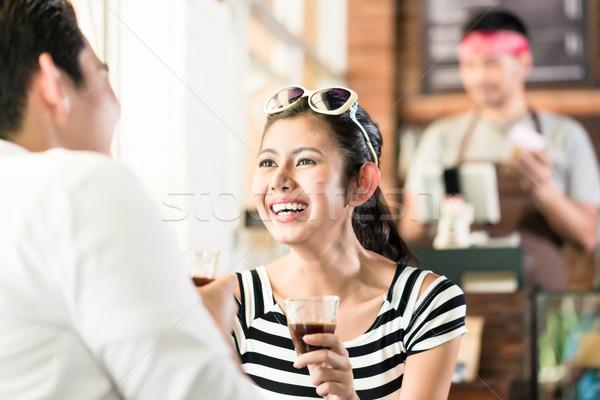 ázsiai pár kávézó flörtöl iszik kávé Stock fotó © Kzenon
