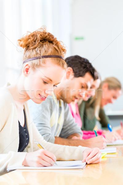 College students writing test or exam Stock photo © Kzenon